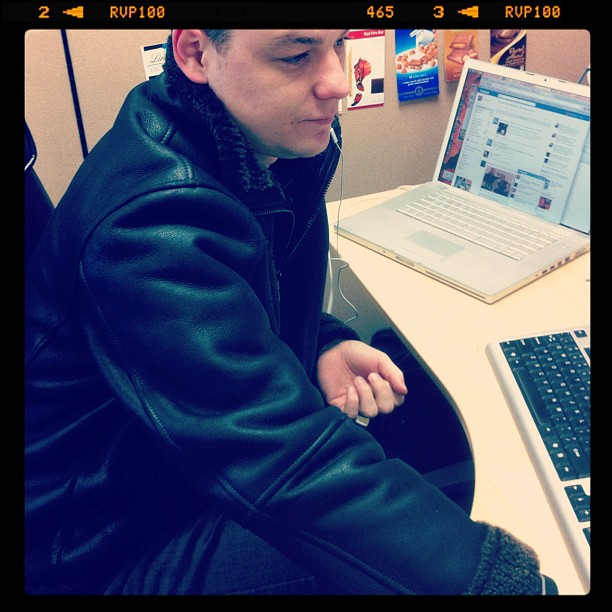 Alex wearing a winter jacket at the office.
