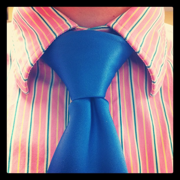 Pink shirt blue tie