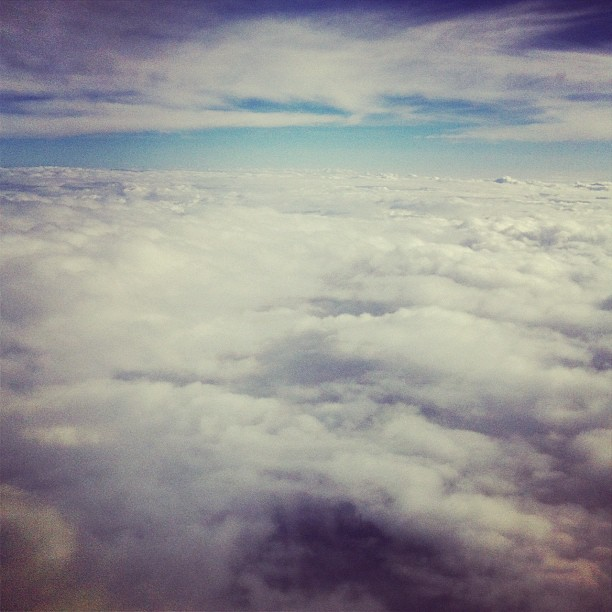 above cloud cover / I reminisce of winter / flight to Seattle