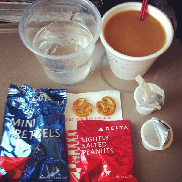 magic of a plane / coffee pretzels and peanuts / rival ambrosia