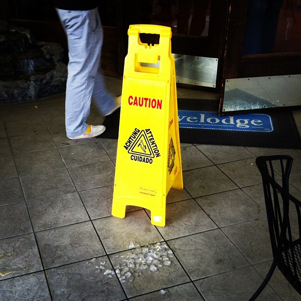 someone spilled the ice / wet floor sign alerts others / while the mess self cleans