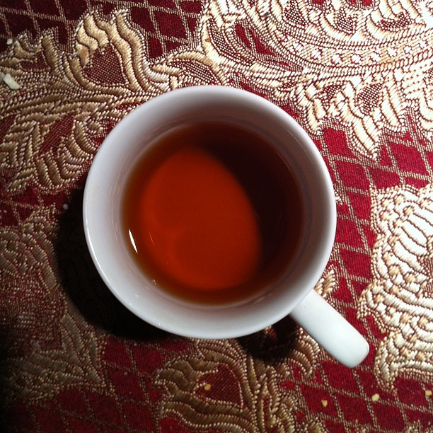 Shot of brandy on a colorful red table cloth
