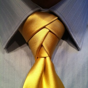 eldredge tie knot on a gold tie