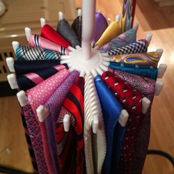 circular tie rack with 20 colorful ties hung on it