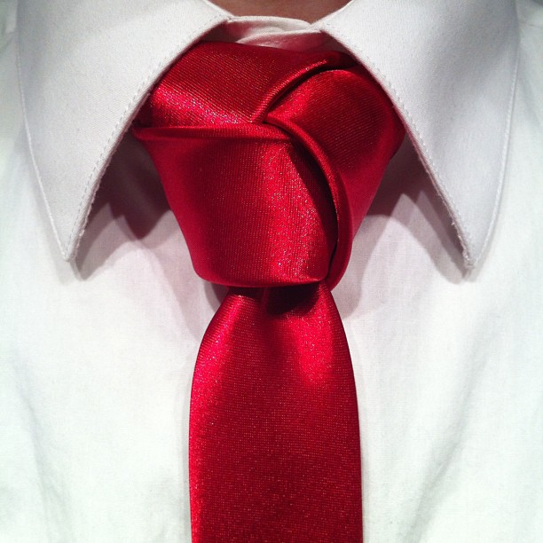Red trinity tie knot on a white shirt