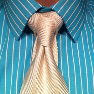 the cape necktie knot white tie on a teal/whit striped shirt