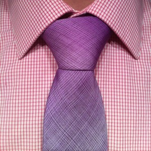 full windsor knot on a purple tie and pink plaid shirt