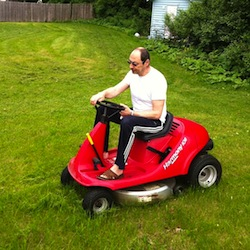 Alex Krasny on a riding lawnmower