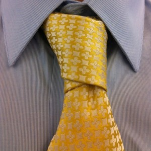cross or christensen knot with a jacket with gold magnetie