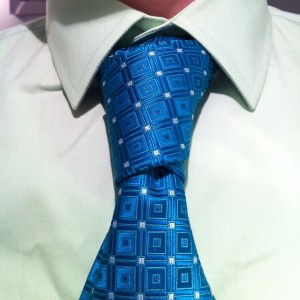 cross or christensen knot on a teal tie