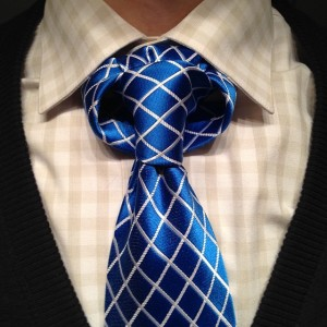 Instruction for tying a linwood taurus necktie knot.