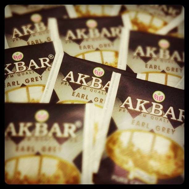 pile of akbar brand tea bags