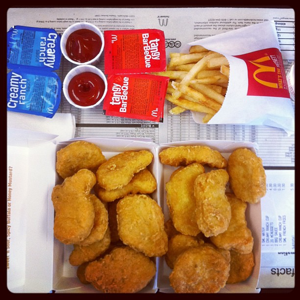 Picture of a McDonalds meal featuring nuggets, fries, and sauces.