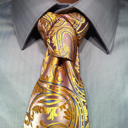 cape knot on paisly pink and yellow tie