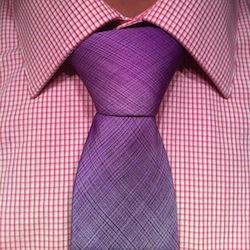 pruple tie on a pink pattern shirt
