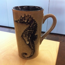 A stylish tea mug with a seahorse on it